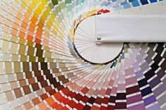The color bars on this site will help you choose colors according to the architectural style of your home. Styles listed are:  Art Deco, Arts & Crafts, Colonial, Cottage, Federal, French Provincial, Scandinavian, Southwestern, Tropical, Tuscan and Victorian.
