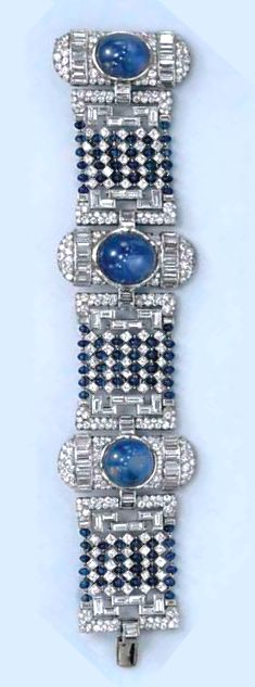 AN ART DECO SAPPHIRE AND DIAMOND BRACELET  Designed as three pavé-set diamond plaques of oblong design, each centering upon a cabochon star sapphire, accented by baguette-cut diamonds, spaced by pavé and baguette-cut diamond geometric links, centering upon alternating sapphire bead and circular-cut diamond articulated panels, mounted in platinum, circa 1935.