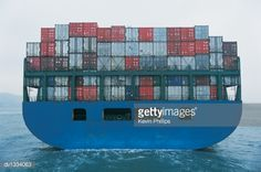 Stock Photo : Rear View of a Cargo Ship Transporting Containers