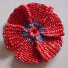 made on a flower loom. The tutorial is here: http://knitting-and.com/small-looms/flowerleaves.htm