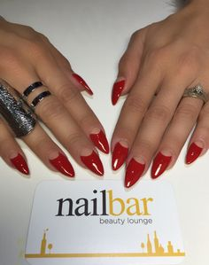 Nude and red halfmoons. Stiletto nails