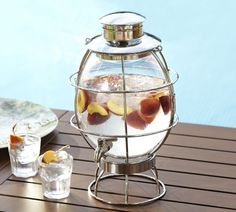 Lantern Drink Dispenser | Pottery Barn. I've been making (and drinking) insane amounts of Brazilian limeade this summer. Wouldn't it look pretty in this?