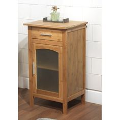 The bamboo linen floor cabinet is perfect for storing linens, toiletries and more. This floor cabinet features bamboo construction with two drawers in a natural wood finish. Bathroom Shelves, Bathroom Flooring, Bathroom Furniture, Bathroom Ideas, Bathroom Cabinets, Bathroom Updates, Bathroom Storage, Glass Cabinet Doors, Glass Door