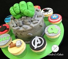 Cake with RKT Hulk fist bursting out of it, surrounded by Avengers cupcakes - Visit to grab an amazing super hero shirt now on sale! Avenger Cupcakes, Hulk Cupcakes, Avenger Cake, Cupcake Cakes, 6 Cake, Avengers Birthday Cakes, Hulk Birthday Parties, Superhero Birthday Party, Birthday Ideas