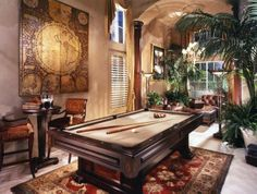 Home billiard room decorated with green plants