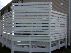 Privacy laths for outdoor bench seating.