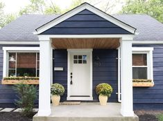 Chesterfield Cottage Reveal: Part 1 {Exterior, Living Room, and Bathroom} Beginning in the Middle. Love the contrast with the white and the natural wood accents. House numbers are great too. Exterior Paint Colors For House, Paint Colors For Home, Navy House Exterior, Cottage Exterior Colors, Navy Blue Houses, Blue House White Trim, Blue Siding, Pintura Exterior, Wood Accents
