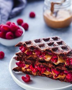 Cocoa waffles with raspberries + almond butter.