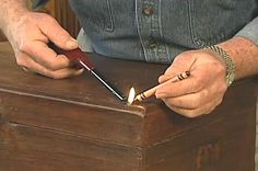 Fixing nicks and gouges in wood furniture with crayons.