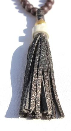 Bronze Metallic Leather Tassel With Antler And Antique Pearl On Matte Purple Jade Beads With Taupe Leather Ties Necklace