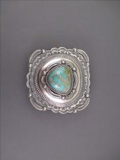Navajo jewelry artist / silversmith Hank Vandever made this detailed Sterling Silver belt buckle featuring a large, beautiful piece of Carico Lake Turquoise