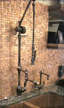 Waterstone gantry faucet...and check out the penny backsplash! Copper instead of stainless...LOVE!!!