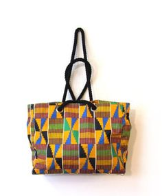 African print. I want this bag ~Latest African Fashion, African women dresses, African Prints, African clothing jackets, skirts, short dresses, African men's fashion, children's fashion, African bags, African shoes ~DK
