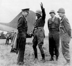 Original caption 'Three U.S. Army field commanders durring (sic) impromptu conference with supreme commander/Sig. C.', General Dwight D. Eisenhower, General George Patton, General Omar Bradley and General Courtney Hodges, March 31, 1945.