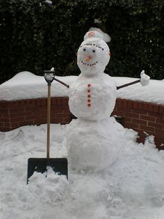 Sometimes Frosty couldn't see the point in moving all that snow, but still managed to keep a smile on his face. :)