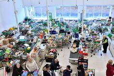 Troops will be deployed to guard hospitals and supermarkets, where panic-buying unleashed carnage on Saturday. Pictured: trolleys piled high for delivery are seen at an Asda in London Tesco Extra, The Final Countdown, Green Pictures, Number 10, Together We Can, Surrey, About Uk, Britain, Death