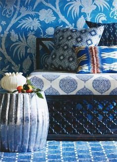Morocco by taloola. If we painted wood furniture dark navy and used mixed print cushion covers.  DIY denim rug. Hammered aluminum tray. Lena Plate grouping.