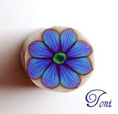 Kato clay.  Purple to blue skinner blen.  Yes there is purple in this flower.