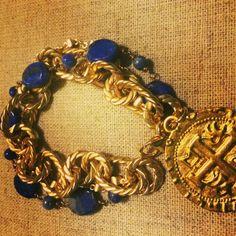 Katherine II Bracelet - Beautiful multi-strand blue lapis and gold bracelet with a hand carved MMLJ medal. $64.00