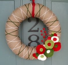 Yarn Wreath Felt Handmade Holiday Door Decoration - Holiday Special 12in. $40.00, via Etsy. OR DIY! I've made one before - they take time, but you save over half the cost it is here :)