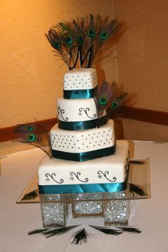 peacock wedding cake - nor the feathers.  Maybe just the color scheme to tie in