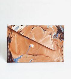 Artfully stows phone, wallet, gloss