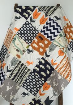 Baby Boy Quilt, Patchwork, Bow and Arrow, Feather River, Chevron, Navy, Orange, Deer, Bear, Crib Bedding, Crib Quilt, Baby Bedding, Nursery by CoolSpool on Etsy https://www.etsy.com/listing/245327234/baby-boy-quilt-patchwork-bow-and-arrow