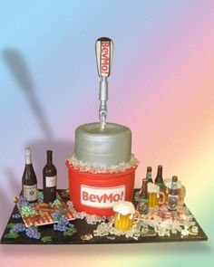 Ice Bucket and Keg Cake Sculpture for Second Day of  Redding BevMo! Grand Opening.  The wine and beer bottles and ice were made of isomalt sugar. The beer mugs were made of rice cereal treats covered in fondant. The grapes and other details were hand formed from fondant.