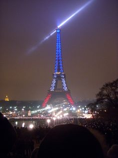 Colors of the french flag light up the Eiffel Tower