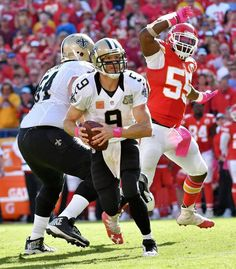 Saints vs. Chiefs  -  27-21, Chiefs  -  October 23, 2016:    New Orleans Saints quarterback Drew Brees escapes Kansas City Chiefs outside linebacker Dee Ford before throwing a fourth quarter touchdown pass during Sunday's football game on October 23, 2016 at Arrowhead Stadium in Kansas City, Mo.