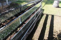 Gutter Garden on chain link fence.