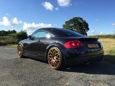 Audi TT black with gold wheels