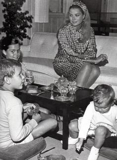 """Ocean City, New Jersey: Princess Grace of Monaco, the former Grace Kelly of Philadelphia, relaxes at her seashore retreat with her children during two-week vacation """"back home."""" The children are, left to right, Princess Caroline, 10, Prince Albert, 9, and Princess Stephanie, 2. September 15, 1967."""