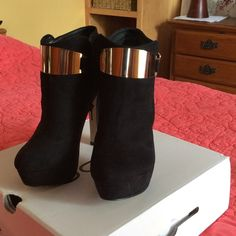 ALDO ankle boots ALDO suede ankle boots, new  with box ,color black ,size 8.5 or 39, zipper inside and gold accents.. ALDO Shoes Ankle Boots & Booties