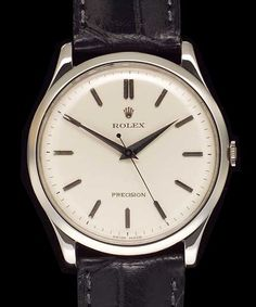 1950's - Rolex Precision: Very Rare Extra Large Steel Round with Antique Silver Dial, Mechanical Movement.