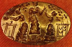 Gold ring showing women at shrines with trees, poppies and crocuses. The central figure appears to be a goddess