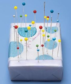 Pincushion idea: Stick needles and pins in a wrapped bar of soap. The soap's oils make the pointy ends glide through fabric.
