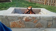 I love our fire pit! DIY made from cinder blocks and hand picked flag stone.