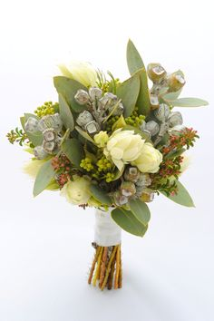 Gorgeous native bouquet in subdued tones.  Stunning!