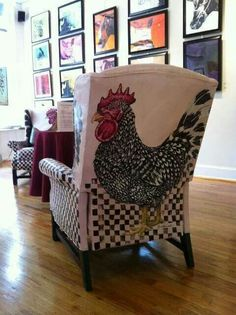 Interesting. Notice chair in background also has a painted rooster pattern on the inside of the chair.  So guess they both have rooster pattern on back and on the front of the chair!!!!