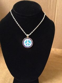 Peace sign pendant with floral border . by TrailsWestTrading