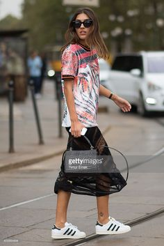 Patricia Manfield is wearing just cavalli in front of the cavalli show in the streets of Milan during the Milan fashion week on September 18, 2014 in Milan, Italy.