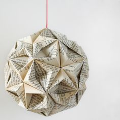 Book Origami Ornament  This beautiful origami ball is hand folded from 30 pages of an old book. Specifically, Geoffrey Chaucer's 'The Prologue & Three Tales' published in 1934 using pages 39-98 (this includes The Nun's Tale). This traditional Japanese kusudama (modular origami ball) consists of 30 individual pieces of paper