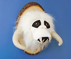 Plush mounted wampa head by Anatomically Incorrect Creatures, who has plush creatures on sale at Etsy.