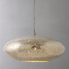 Made in a factory in Egypt from silver-plated copper, the lamps have been punctured with thousands of tiny holes that create stunning effects when the light filters through them and casts shadows on the surrounding surfaces.  Oriental Lighting Collection's handmade lights are unique in every way and will add a distinctive sense of character and personality to every home that features them.
