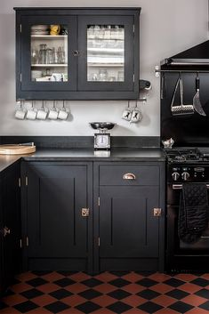 ooh I like the red blue tiles, dark grey units. Alexis Hamilton Photography's shoot for British Standard Cupboards Featured in Beautiful Kitchens Magazine February Stunning Black Kitchen Design with Honed Black Granite Worktops and Georgian Brass Handles Interior Modern, Interior Exterior, Kitchen Interior, Kitchen Design, Kitchen Decor, Boho Kitchen, Diy Interior, Kitchen Ideas, British Standard Kitchen