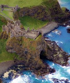 Aerial view of Dunluce Castle, Co. Antrim, Ireland, with Mermaid's Cave beneath.