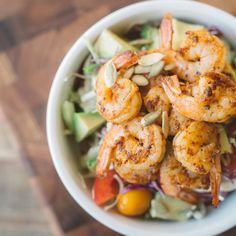 Taco Tuesday and Cinco de Mayo?! We have the perfect recipe. This healthy  Shrimp Taco Bowl from Kelly LeVeque of Be Well By Kelly will appease your  taste buds and omega 3 needs.This shrimp taco bowl puts a twist in the  traditional taco salad. YUM. The bestpart about a slaw is it can be made