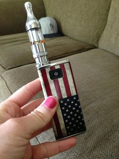 My iTaste MVP with Kanger ProTank I. Compliments to JWrap for the amazing 'Merican cover. Fits perfectly and looks awesome.