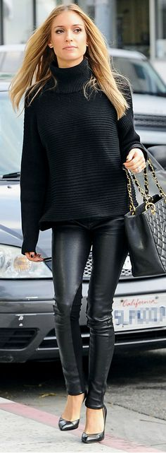All black. Leather leggings, quilted handbag, classic pumps, and cuddly knit sweater